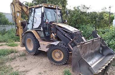 Екскаватор навантажувач Caterpillar 428 2002 в Новій Каховці