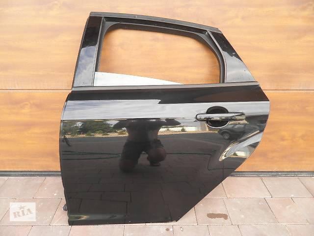 продам Б/у дверь задняя для легкового авто Ford Focus бу в Чернигове