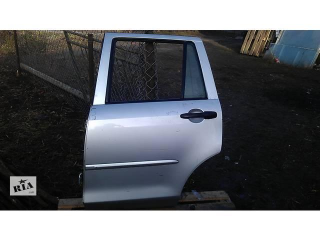 продам Б/у дверь задняя для легкового авто Mazda 2 бу в Львове