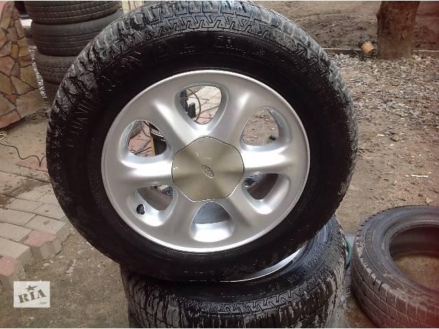 продам Б/у диск с шиной для легкового авто Ford Scorpio 1994 бу в Львове