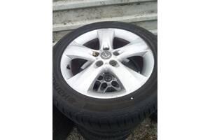 Б/у диск с шиной для Opel Astra J