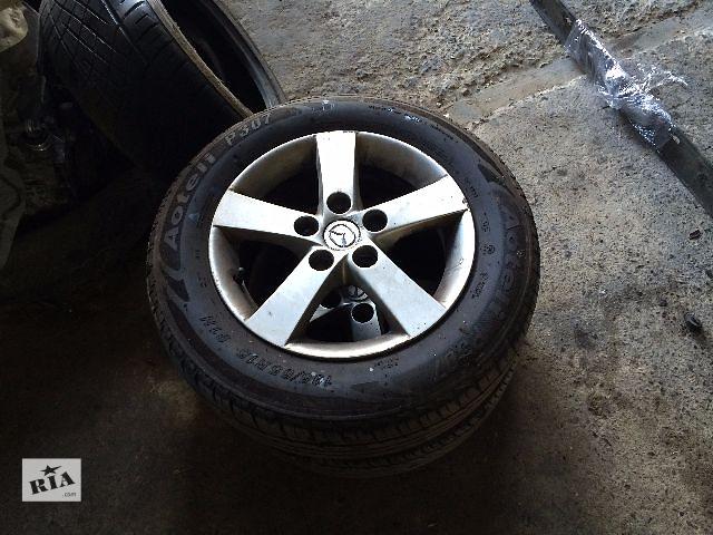 продам б/у Диски литые 4шт R- 15 Mazda 3 2006 бу в Львове