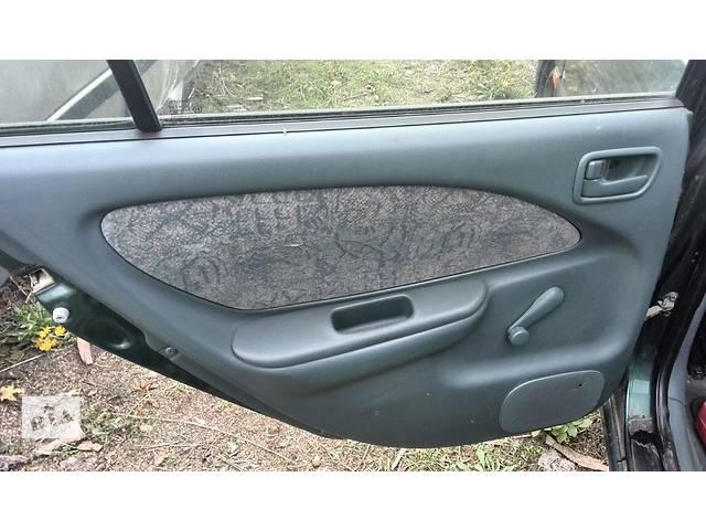 купить бу Б/у карта двери задняя левая 67020-05010-B0 для седана Toyota Avensis 1999г в Николаеве