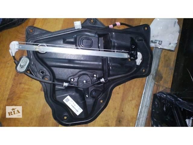 купить бу Б/у стеклоподъемник задній правий  Mazda 3 BM №2264000 в Львове
