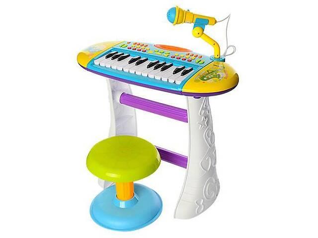 продам Детское пианино-синтезатор с микрофоном и стульчиком на ножках 24 клавиши Limo Toys, желтый бу в Киеве