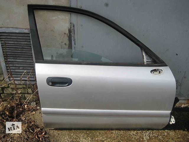 продам  Дверь передняя для легкового авто Mitsubishi Carisma бу в Львове