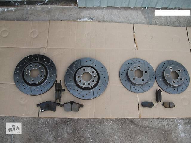 купить бу Перфорированные тормозные диски +колодки,перед 5х110х308,зад 5х110х264 для Опель Астра Н/Зафира В/Opel Astra H/Zafira B в Золотоноше