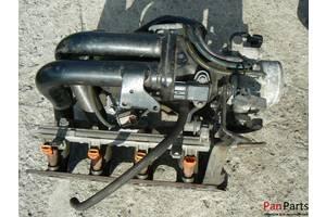 б/у Коллекторы впускные Mitsubishi Lancer