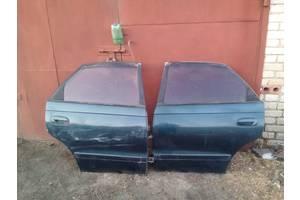 Двери задние Toyota Carina E