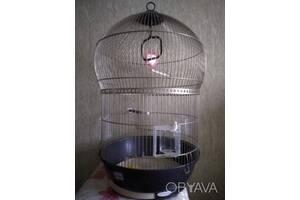 Кругла клітка для папуг